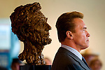 "HOLD FOR A3..Gov. Schwarzenegger stands near the bust of President Abraham Lincoln, inside the California Museum, as part of a kickoff ceremony for the museum's hosting of the Lincoln Bicentennial Exhibit. The bust came from his office in the State Capitol. The exhibit titled ""With Malice Toward None: The Abraham Lincoln Bicentennial Exhibition"" opens at the Library of Congress in Washington, D.C. today and will travel to five select venues across the U.S., stopping first at Sacramento's California Museum, where it will be housed from June 24 through August 22.  Photo taken Thursday Feb. 12, 2009"