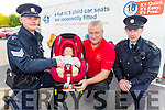 Check it Fits: Sargent Dermot O'Connell with Ron Richardson RSA and Garda Finbarr Donovan at the Child Car seat free fitting in Killarney on Tuesday