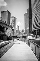 Chicago Riverwalk black and white picture. Chicago Riverwalk is a popular downtown Chicago walking path along the Chicago River and buildings.