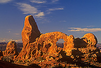 714000075 famed turret arch a sandstone formation turns reddish gold in low angled winter morning light in arches national park utah