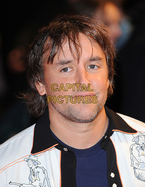 RICHARD LINKLATER.'Me & Orson Welles' UK film premiere at the Vue West End, Leicester Sqaure, London, England.November 18th, 2009.headshot portrait white black cowboy drawings orange trim stubble facial hair.CAP/BEL.©Tom Belcher/Capital Pictures.