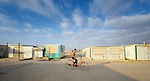 A boy rides his bike in the Zaatari refugee camp near Mafraq, Jordan. Established in 2012 as Syrian refugees poured across the border, the camp held more than 80,000 refugees by early 2015, and was rapidly evolving into a permanent settlement. The ACT Alliance provides a variety of services to refugees living in the camp.