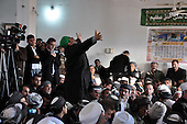 BIARA, IRAQ: A dervish partakes in the celebration of Mullah Osman's birthday at the Biara Madrassa and Mosque...The Biara Madrassa--a religious school--is located high up in the mountainous Kurdish Hawraman region that makes up the Iran/Iraq border. Before 2003 the region was home to a fundamentalist Islamic group called Ansar al-Islam who used the school as a base. The Unites States military attacked the area and the madrassa numerous times during the 2003 invasion, finally pushing Ansar al-Islam out...Today the madrassa is home to 48 male students from all across Kurdish Iraq. The students leave their families and immerse themselves in their studies and the daily life of Koranic students...Photo by Besaran Tofiq