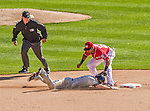 27 April 2014: Washington Nationals shortstop Ian Desmond gets Chris Denorfia out at second on a double play in the 9th inning against the San Diego Padres at Nationals Park in Washington, DC. The Padres defeated the Nationals 4-2 to to split their 4-game series. Mandatory Credit: Ed Wolfstein Photo *** RAW (NEF) Image File Available ***