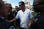 UK head coach John Calipari greets police officers before the first half of the UK vs U of L football game, kicking off Joker Phillip's reign as head coach on Saturday, September 5, 2010. Photo by Britney McIntosh | Staff