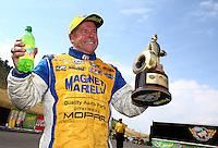 Jul. 20, 2014; Morrison, CO, USA; NHRA pro stock driver Allen Johnson celebrates after winning the Mile High Nationals at Bandimere Speedway. Mandatory Credit: Mark J. Rebilas-