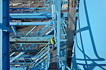 A crane operator looks out over the container yard at the APM Terminal at the Port of Rotterdam, on Tuesday Oct. 27, 2009, in Rotterdam, the Netherlands. (Photo © Jock Fistick)