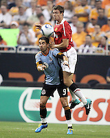 Juan Pablo Angel #9 of the MLS All-Stars  loses a header to Jonny Evans #23 of Manchester United during the 2010 MLS All-Star match at Reliant Stadium, on July 28 2010, in Houston, Texas. Manchester United won 5-2.