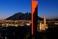 Faro del Comercio in Monterrey is a monument designed by Mexican architect Luis Barragan and constructed in 1984 by architect Raul Ferrara.The Tallest monument in Mexico that stands for commerce contrasts to the City's Cathedral, a traditional landmark. Orange colored Lighthouse of Commerce stands 230 feet on the city's plaza with Serro de la Silla, a mountain range shaped like a saddle in background.