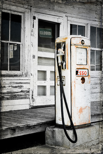 This gas pump was found at a country general store that had been long closed along the main road into the Outer Banks in North Carolina, out of both business and gasoline. Nowadays, it sits with another companion pump selling premium and they have been simply watching the traffic go by on the new road out front for a few decades now. A small interesting tidbit about this dated and obsolete relic is showing on the pump face: sixty-one cents a gallon!<br /> <br /> A few modern digital tricks were used to age and season this photograph without the help of time and wear. The image was originally taken in full color and converted to black and white, then some of the colors were borrowed back and selectively hand painted in at reduced strength. A distressed and gritty digital overlay was added to the edges to make it appear to be an old worn print. There...aged to perfection&hellip;!