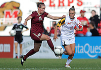 COLLEGE PARK, MD - OCTOBER 21, 2012:  Riley Barger (10) of the University of Maryland moves in on Isabella Schmid (11) of Florida State during an ACC women's match at Ludwig Field in College Park, MD. on October 21. Florida won 1-0.