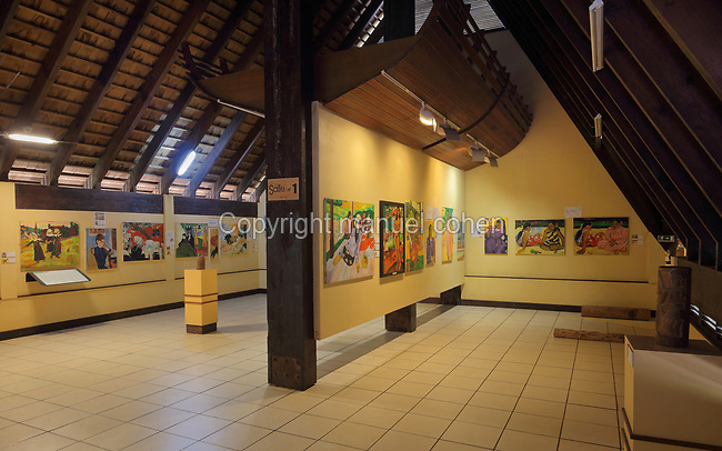 Exhibition inside the Paul Gauguin Cultural Center, a museum which opened in 2003, in Atuona, on the island of Hiva Oa, in the Marquesas Islands, French Polynesia. The museum includes a reconstruction of the Maison du Jouir or House of Pleasure, home to French artist Paul Gauguin, 1848-1903, from 1901 to his death, a traditional 2-storey hut with a wooden lintel carved by Gauguin in 1901 with the inscription, 'Be mysterious. Be loving and you will be happy'. Picture by Manuel Cohen