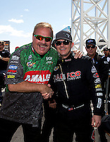 Mar 30, 2014; Las Vegas, NV, USA; NHRA top fuel driver Terry McMillen (left) with Steve Torrence during the Summitracing.com Nationals at The Strip at Las Vegas Motor Speedway. Mandatory Credit: Mark J. Rebilas-