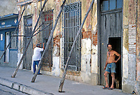 Man Posing in Doorway, Fortified Housing, Branches enforcing walls, Cienfuegos, Cuba, Republic of Cuba, , pictures of front door entrances