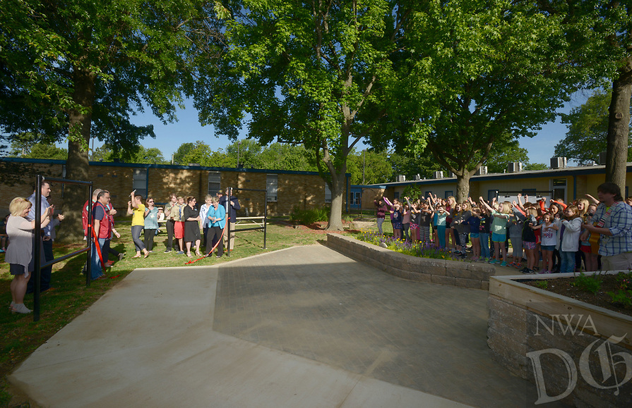 NWA Democrat-Gazette/BEN GOFF @NWABENGOFF<br /> The Northside Panther Choir (right) cheers as guests cut the ribbon Monday, May 15, 2017 during a ribbon-cutting for the new outdoor classroom at Northside Elementary School in Rogers. The school took the oportunity to thank the Rogers Public Education Foundation and local businesses including Lowe's Home Improvement, Milestone Construction Company and Gall Excavation Inc. which made the project possible. The outdoor classroom was complemented by raised planting beds and benches made by local Eagle Scouts, and a butterfly garden built by teachers.
