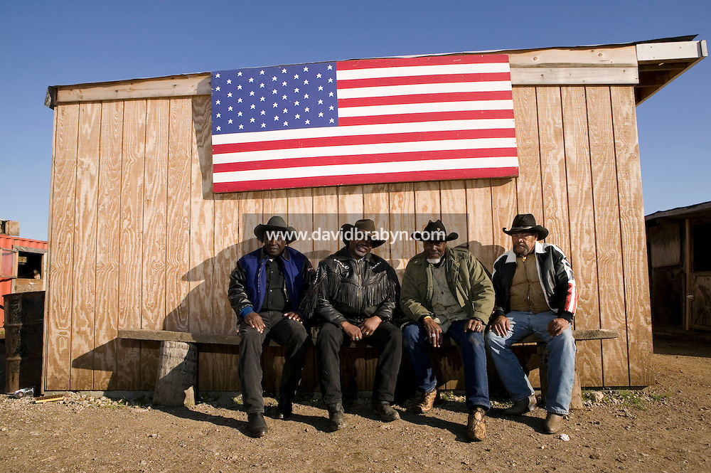 2 December 2006 - New York City, NY - (LtoR) Doctor D, Karl Washington, aka Cowboy Wash, Willie Dunn and Jessie Wise, members of the Federation of Black Cowboys, pose for the photographer at the Cedar Lanes stables in the borough of Queens in New York City, USA, 2 December 2006. The Federation gathers black men and women who recreate the heritage of black cowboys, teach kids to ride and put on 'rodeo showdeos'.