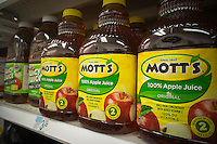 "Bottles of Mott's apple juice are seen on a supermarket shelf in New York on Thursday, September 15, 2011. Popular TV doctor, Dr. Mehmet Oz is under criticism because of his comments, interpreted as fear-mongering and irresponsible by critics, about the presence of arsenic in apple juice. Oz claims that a lab found ""troubling"" levels of the chemical in various brands but the FDA, testing the same batches, found no such thing. (© Richard B. Levine)"