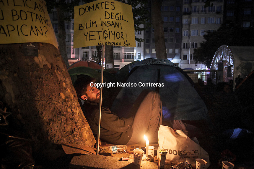 In this Saturday, Jun. 08, 2013 photo, a protester sits as he camps at night in Gazi park of Taksim Square during a 24/7 masive rally against the turkish government in Istanbul, Turkey. (Photo/Narciso Contreras).