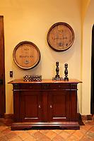 The heads of wine barrels make for unique art the connoisseur