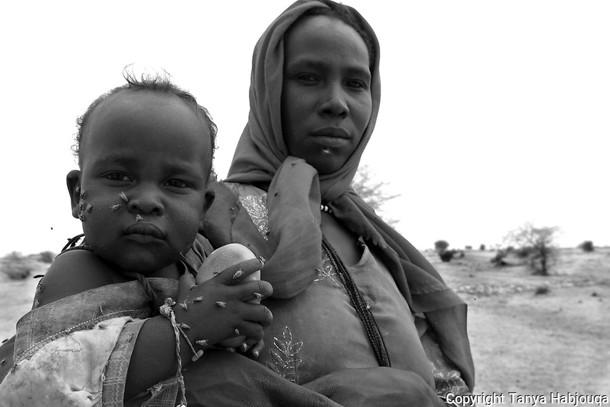 Darfur Refugee flees to Chad by land with child.