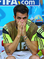 Cesc Fabregas of Spain looks on from the substitutes bench