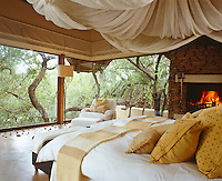 This bedroom which has floor-to-ceiling glass walls enclosed by nothing more than sticks emphasises the idea of being in the wild yet surrounded by luxury