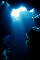 MARINE LIFE: REEFS, CAVERNS &amp; DIVERS<br /> Tyndall Effect: Sun beams in cavern<br /> Underwater shot showing Tyndall Effect in water, the scattering of light by colloidal particles or particles in suspension.