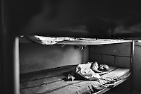 A very ill young girl in an orphanage in Kampala, Uganda on April 20, 2001. More than 13 million African children have been orphaned by the the AIDS pandemic. Worldwide, more than 20 million people have died since the first cases of AIDS were identified in 1981.