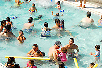 People enjoy ?Family Splash Time? during Santa Monica Swim Center's during t10 Year Anniversary Party on Saturday, July 21, 2012.