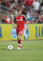 18 July 2012: Toronto FC midfielder Terry Dunfield #23 in action during an MLS game between the Colorado Rapids and Toronto FC at BMO Field in Toronto, Ontario..Toronto FC won 2-1..
