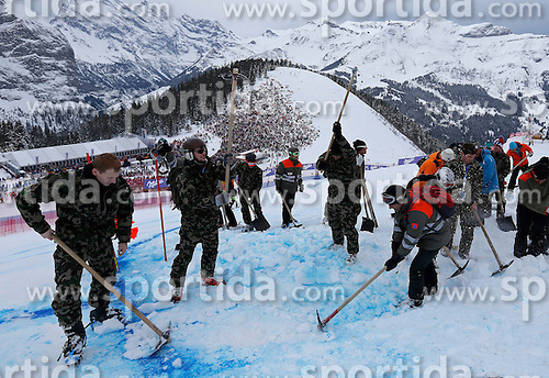 18.01.2014, Lauberhorn, Wengen, SUI, FIS Weltcup Ski Alpin, Wengen, Abfahrt, Herren, im Bild Die Armee praepariert die Piste fuer den Start unterhalb der Minschkante // during the mens downhill of the Wengen FIS Ski Alpine World Cup at the Lauberhorn in Wengen, Switzerland on 2014/01/18. EXPA Pictures &copy; 2014, PhotoCredit: EXPA/ Freshfocus/ Christian Pfander<br /> <br /> *****ATTENTION - for AUT, SLO, CRO, SRB, BIH, MAZ only*****