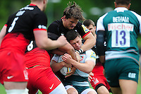 Ben Youngs of Leicester Tigers is tackled by Michael Rhodes of Saracens. Aviva Premiership semi final, between Saracens and Leicester Tigers on May 21, 2016 at Allianz Park in London, England. Photo by: Patrick Khachfe / JMP