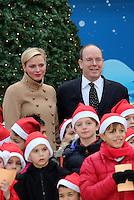 Princess Charlene of Monaco and Prince Albert II of Monaco attend the Christmas Celebration - Monaco
