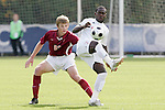 11 November 2008: NC State's Ronnie Bouemboue (right) and Virginia Tech's Taylor Walsh (23). North Carolina State University defeated Virginia Tech 3-1 at Koka Booth Stadium at WakeMed Soccer Park in Cary, NC in a men's ACC tournament first round game.