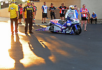 Jun. 30, 2012; Joliet, IL, USA: NHRA pro stock motorcycle rider Hector Arana Jr pushes his bike to the starting line during qualifying for the Route 66 Nationals at Route 66 Raceway. Mandatory Credit: Mark J. Rebilas-