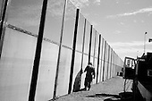 San Luis, Arizona.USA.October 23, 2006..The US National Guard constructs a three tiered fence along the Mexican - USA border near the San Luis port of entry. The second metal meshed fence is placed deep into the ground to keep illegal immigrants from digging under the fence to enter. Border patrol vehicles run between the three fences to catch those trying to enter. Thousands of illegal immigrates cross at this point every year..