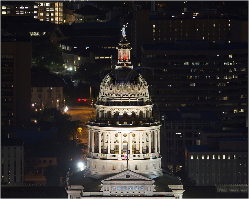 This picture of the cupola of the Texas Capitol was taken with a telephoto lens from a highrise in downtown Austin, Texas. I wanted to show a bird's eye view, as well as the detail in the top of the pink granite building.