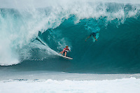 BANZAI PIPELINE, Oahu/Hawaii (Saturday, December 10, 2011) John John Florence (HAW) with  Kelly Slater (USA) duck diving the wave. . – Kieren Perrow (AUS), 34, has won his inaugural ASP World Tour event, taking out the Billabong Pipe Masters in Memory of Andy Irons over fellow countrymen Joel Parkinson (AUS), 30, in four-to-six foot waves. John John Florence (HAW), 19, also found his way to the podium as the overall winner of the 2011 Vans Triple Crown...Perrow, who finished runner-up to Jeremy Flores (FRA), 23, in last year's Billabong Pipe Masters, returned to form again this year and charged the massive Pipeline conditions on the opening two days of competition to solidify his position on the 2012 ASP World Tour. The Australian was equally deadly in the smaller conditions on the final day and commanded the Final against Parkinson in a backdoor shootout to secure his maiden ASP World Tour victory...John John Florence put on an amazing show at this year's Billabong Pipe Masters, taking the event's only two perfect 10-point rides,  but fell to Slater in the Quarterfinals. Florence's overall effort including a win at the Vans World Cup of Surfing at Sunset Beach and a 5th place at the Reef Hawaiian Pro secured his first Vans Triple Crown win, making him the youngest competitor in history to win the prestigious series.  Photo: joliphotos.com