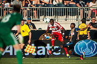 Jackson (6) of FC Dallas crosses the ball under pressure from Raymon Gaddis (28) of the Philadelphia Union. The Philadelphia Union and FC Dallas played to a 2-2 tie during a Major League Soccer (MLS) match at PPL Park in Chester, PA, on June 29, 2013.