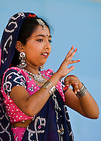 A girl dressed in traditional Indian attire looks on during dancing at the Charlotte Dragonboat Association racing on Lake Norman in NC.