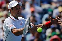 Novak Djokovic of Serbia returns a shot against Kei Nishikori of Japan during men semifinal match at the US Open 2014 tennis tournament in the USTA Billie Jean King National Center, New York.  09.05.2014. VIEWpress