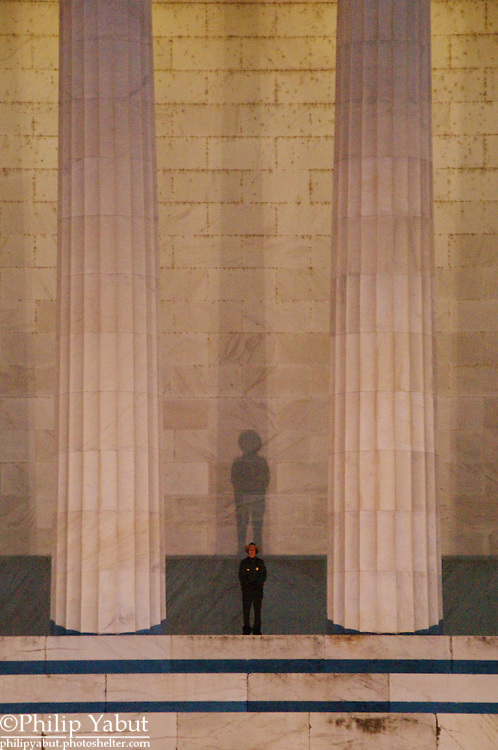 A National Park Service ranger looks out over the Potomac River from the back of the Lincoln Memorial.