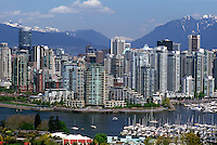 Vancouver, BC, British Columbia, Canada - City Skyline, False Creek, Yaletown Highrise Buildings, North Shore Mountains (Coast Mountains), Spring