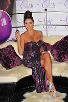 Amy Childs.Launches her debut fragrance 'Amy Childs' at Aura London, England..August 15th, 2012.full length purple strapless sequins sequined dress slit split sitting silver sandals shoes legs crossed .CAP/CJ.©Chris Joseph/Capital Pictures.