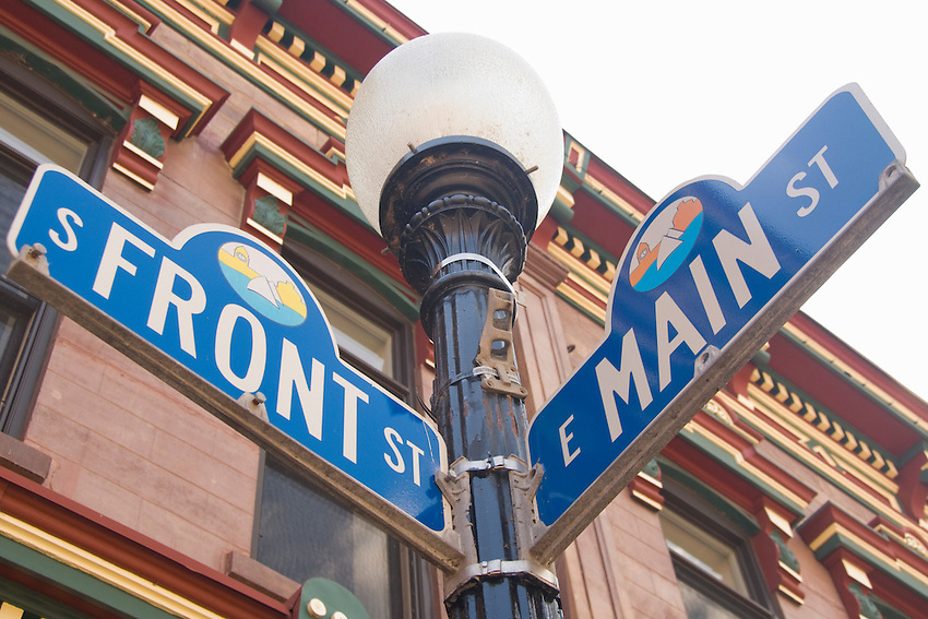 Street signs for Front and Main Streets in downtown Marquette Michigan.