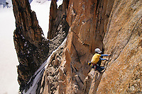 James McHaffie leading the crux 8b pitch of the Voie Petit, Grand Capucin, Mont Blanc range