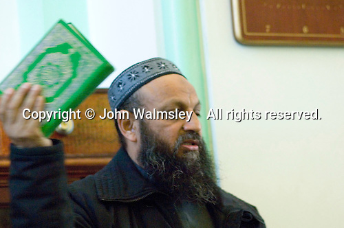 Secondary school visit to the Shah Jahan Mosque, Woking.  The Imam talks about the Muslim religion.