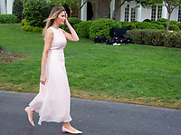 First lady Melania Trump walks back to the West Wing after reading &quot;Party Animals&quot; by Kathie Lee Gifford to a group of children as she and United States President Donald J. Trump host the annual Easter Egg Roll on the South Lawn of the White House in Washington, DC on Monday, April 17, 2017.<br /> CAP/MPI/CNP/RS<br /> &copy;RS/CNP/MPI/Capital Pictures