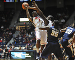 "Ole Miss' Martavious Newby (1) and Ole Miss' Demarco Cox (4) vs. East Tennessee State's Kinard Gadsden-Gilliard (35) at the C.M. ""Tad"" Smith Coliseum in Oxford, Miss. on Saturday, December 14, 2012. Mississippi won 77-55 to improve to 7-1. (AP Photo/Oxford Eagle, Bruce Newman).."