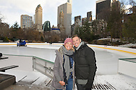 The just engaged couple posing with Wollman Rink and Central Park South in the background.